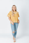 The Harrison Scallop Detail Blouse in Mustard, studio shoot; front view