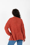 The India Cozy Button Cardigan in Brick, studio shoot; back view
