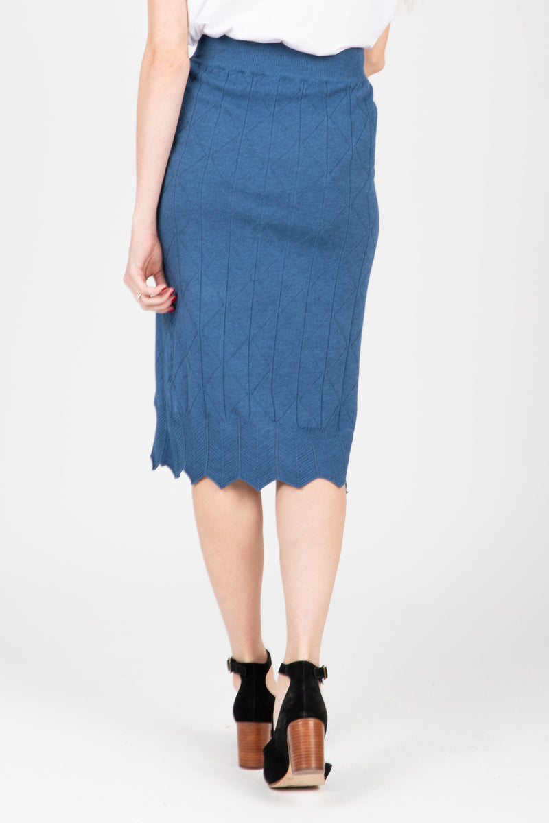 The James Sweater Skirt in Indigo, studio shoot; back view