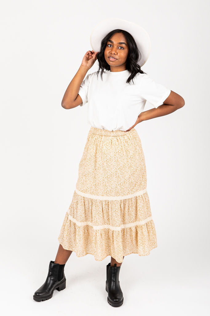 The Angela Patterned Skirt in Mustard, studio shoot; front view