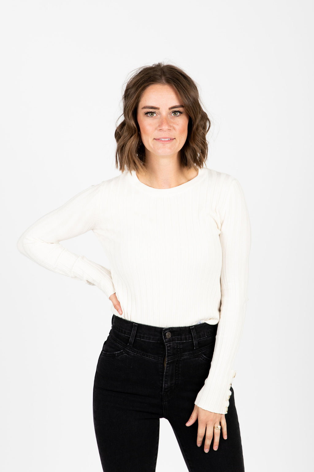 The Melvin Button Cuff Ribbed Blouse in Cream, studio shoot; front view