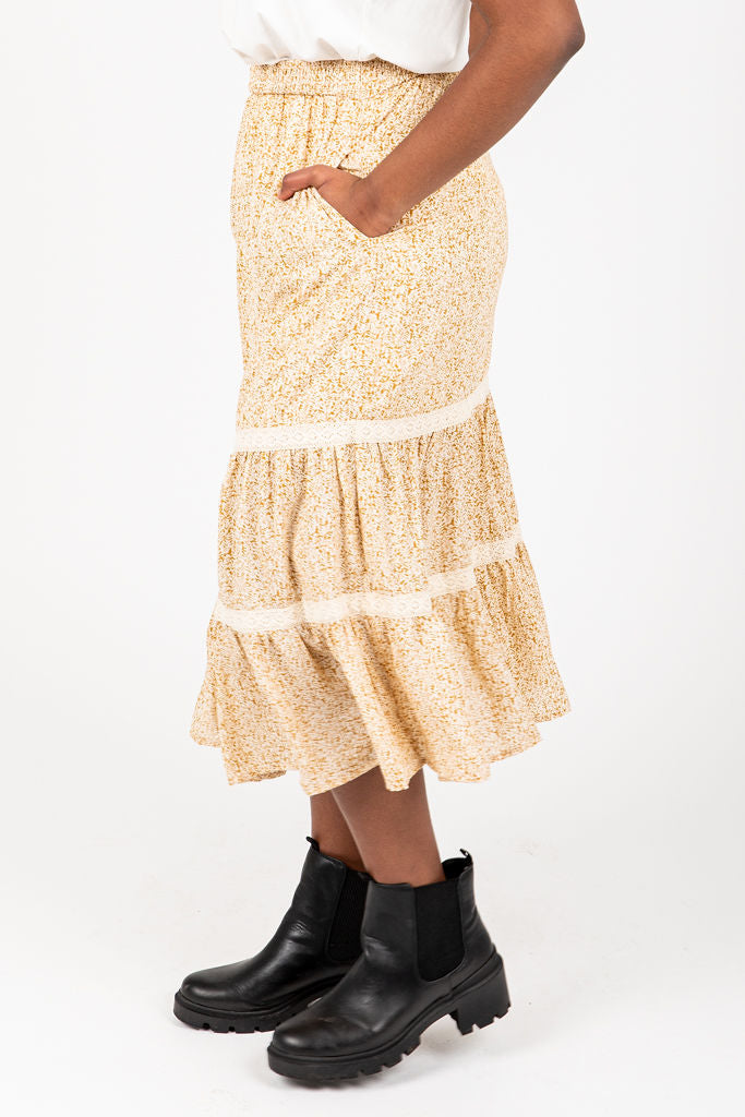 The Angela Patterned Skirt in Mustard, studio shoot; side view