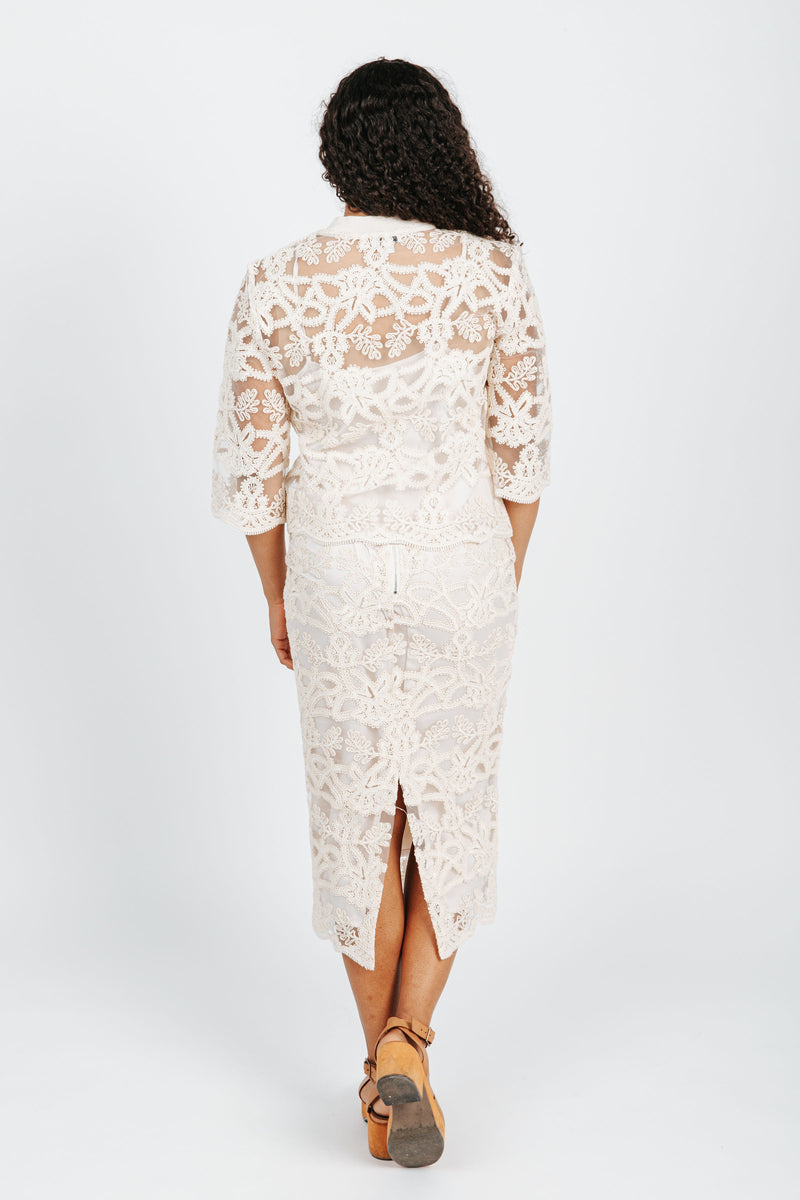 The Drew Lace Embellished Blouse in Cream, studio shoot; back view