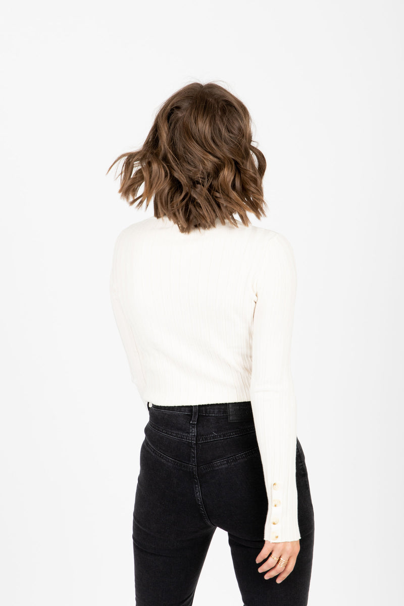 The Melvin Button Cuff Ribbed Blouse in Cream, studio shoot; back view