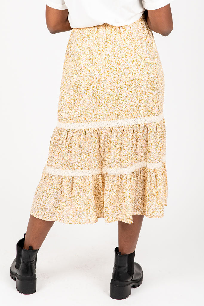 The Angela Patterned Skirt in Mustard, studio shoot; back view