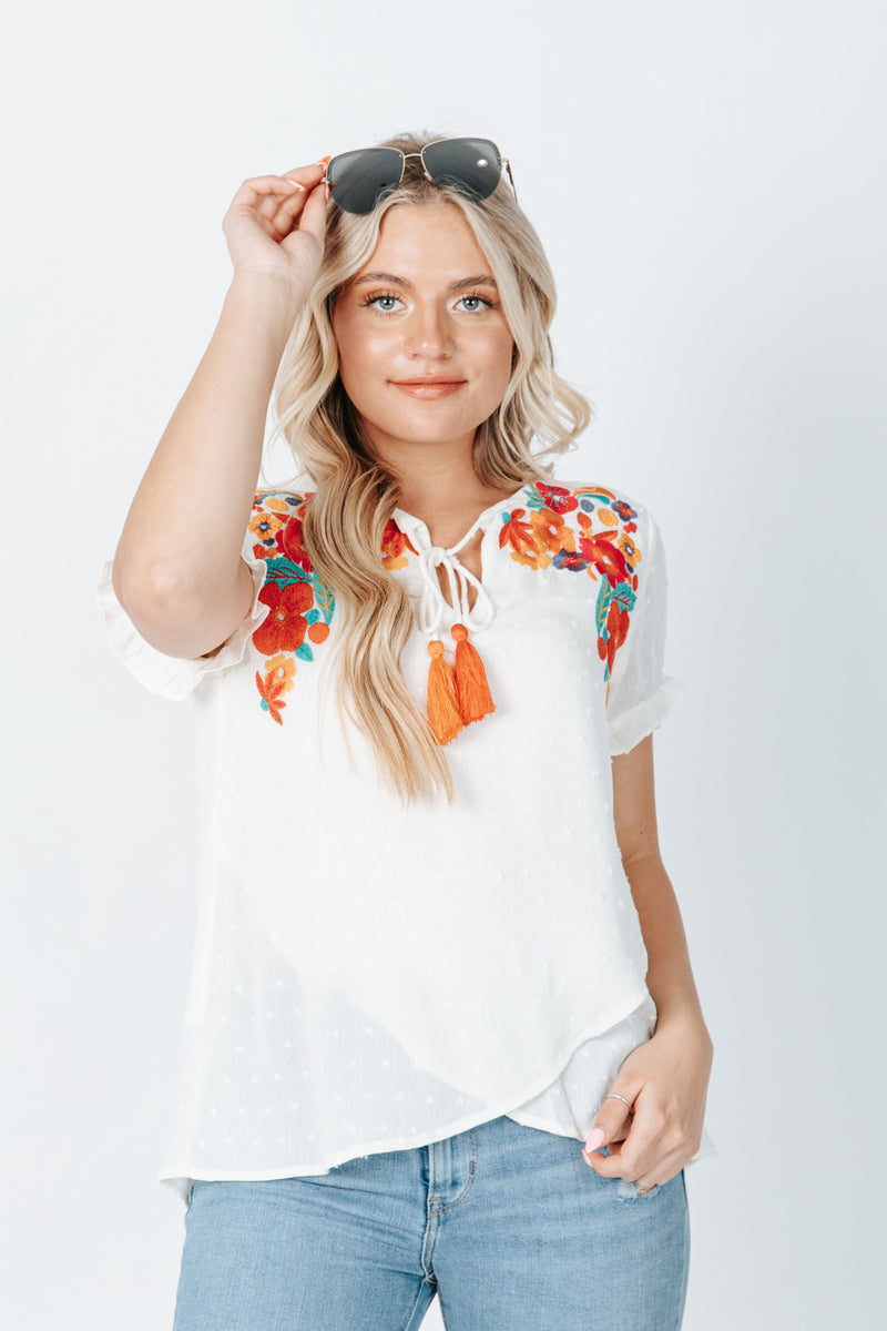 The Audra Embroidered Swiss Dot Blouse in Cream, studio shoot; front view