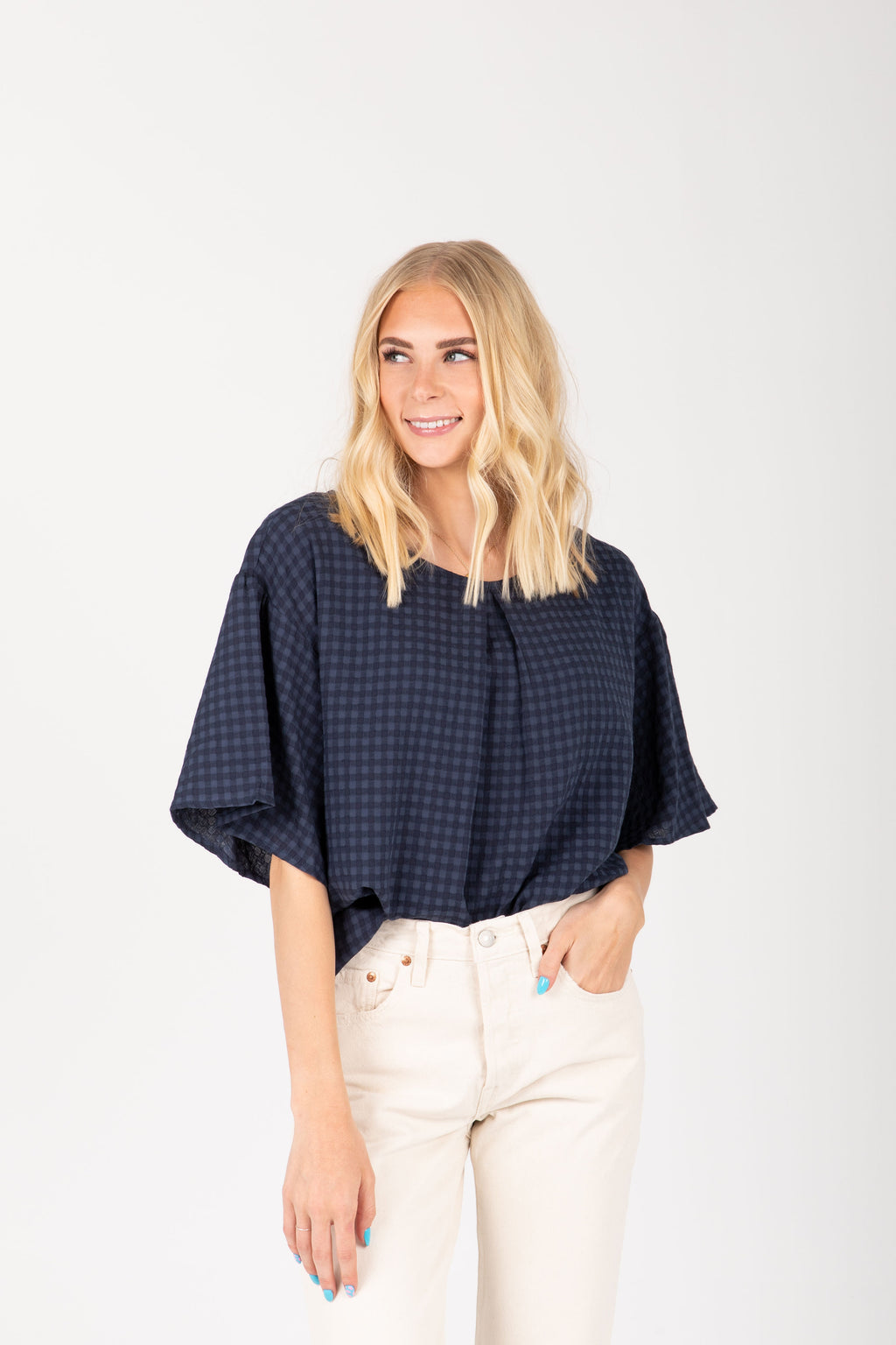 The Bridger Gingham Pleated Blouse in Navy, studio shoot; front view