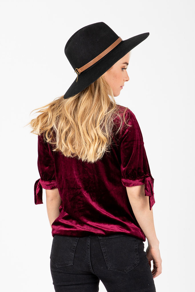 The Velvet Button Peplum Blouse in Burgundy