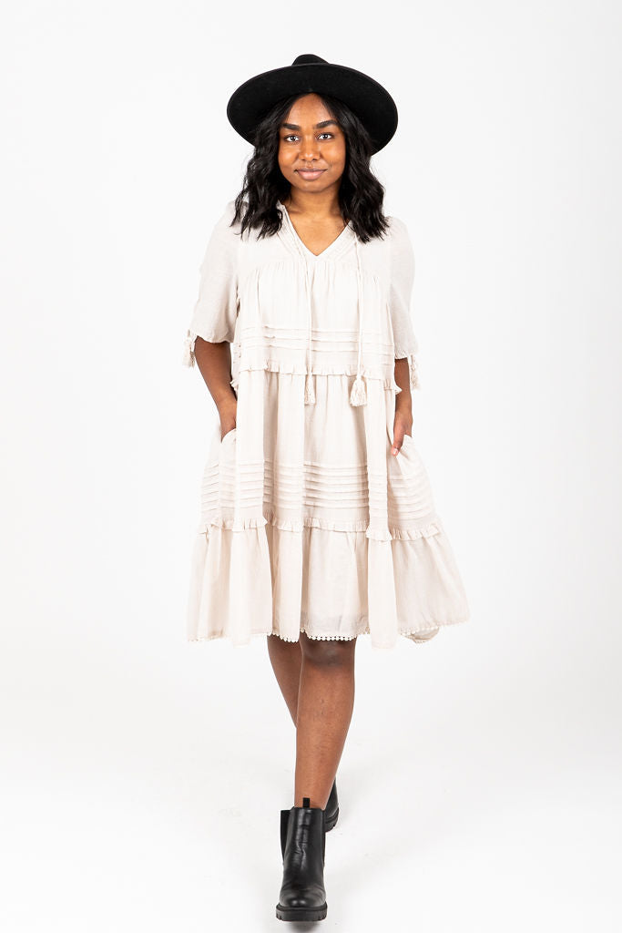 The Sydney Ruffle Detail Dress in Natural, studio shoot; front view