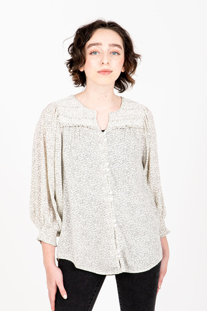 The Natalie Smocked Blouse in Ivory, studio shoot; front view