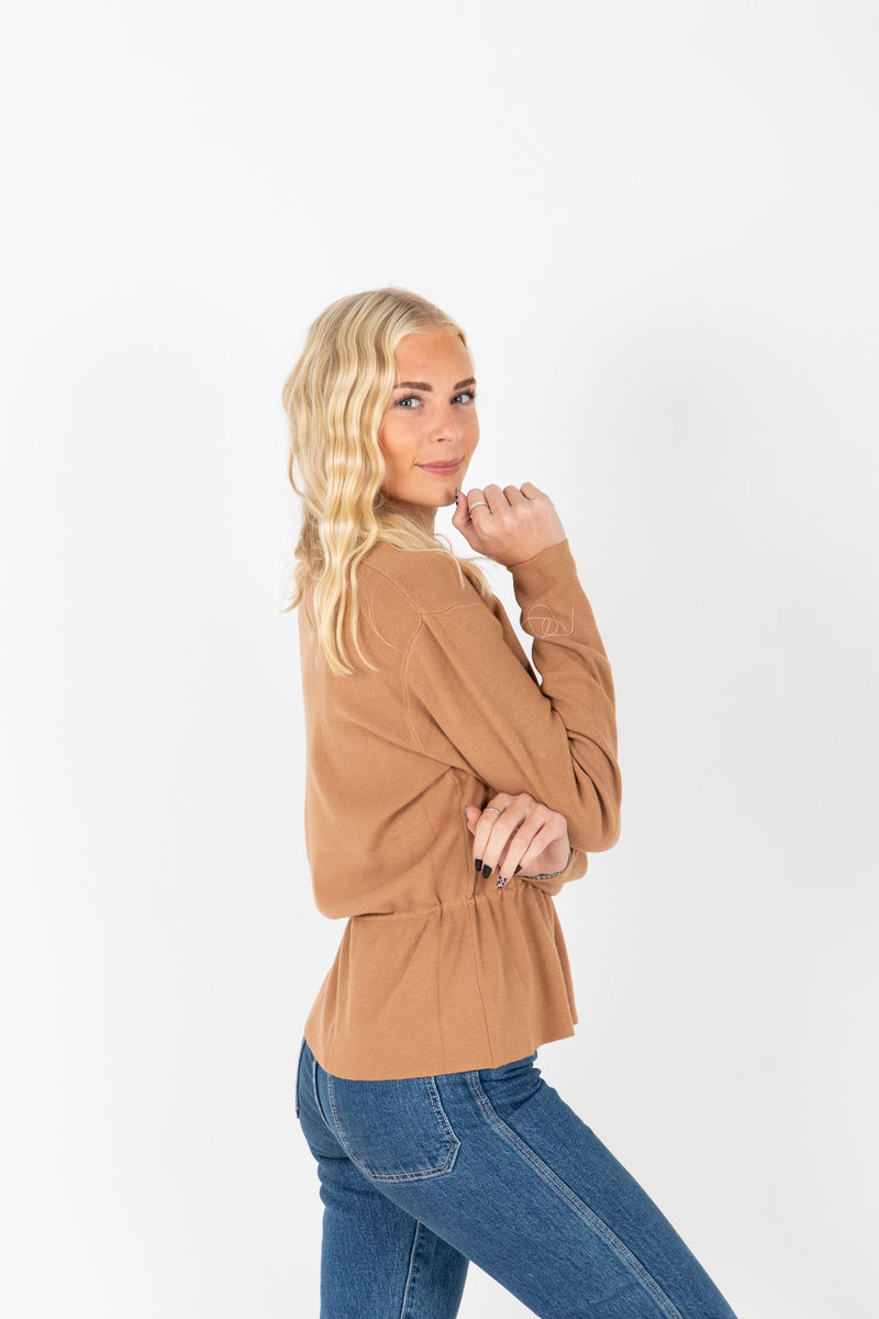 The Miley Ruffle Knit Blouse in Tan, studio shoot; side view