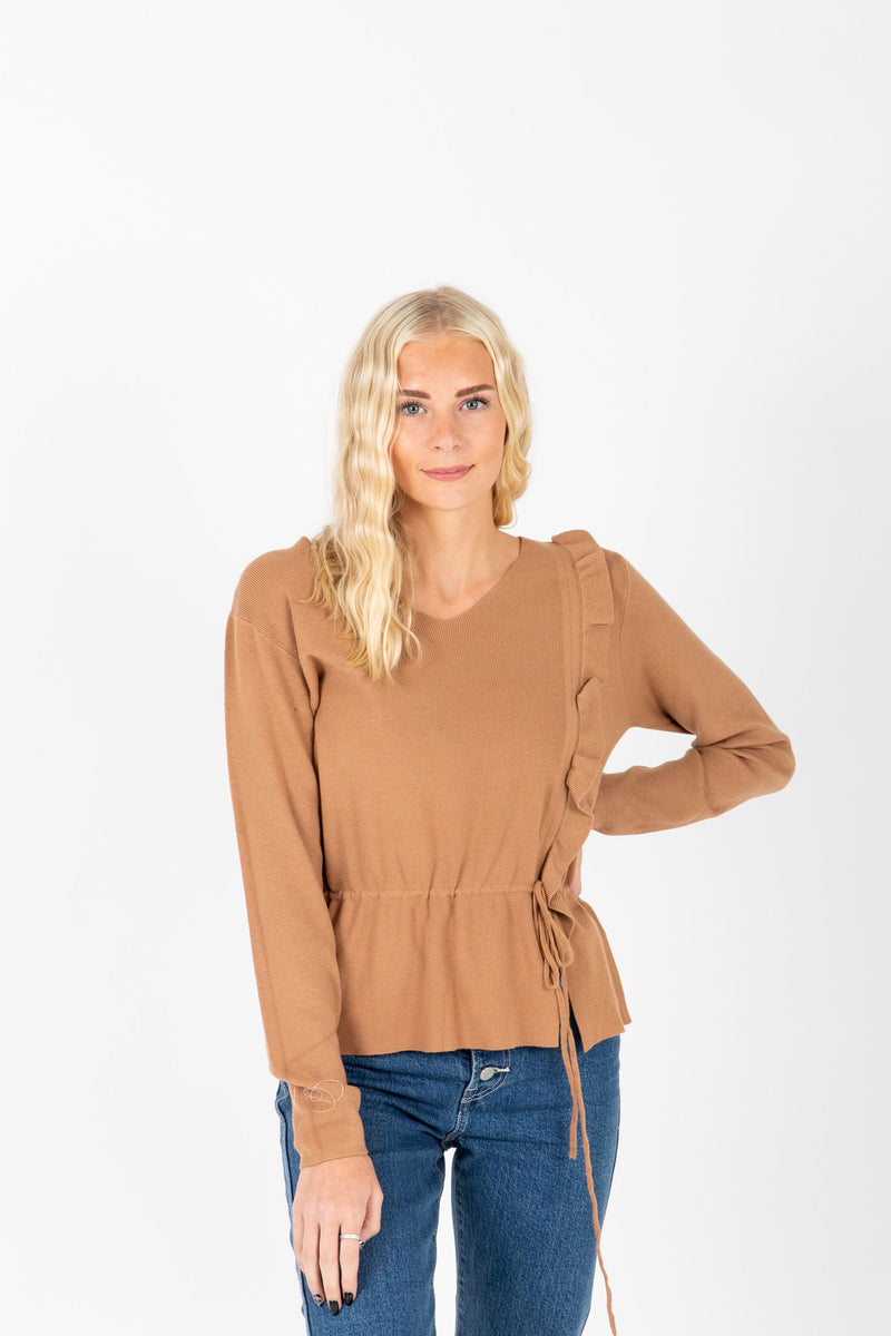The Miley Ruffle Knit Blouse in Tan, studio shoot; front view