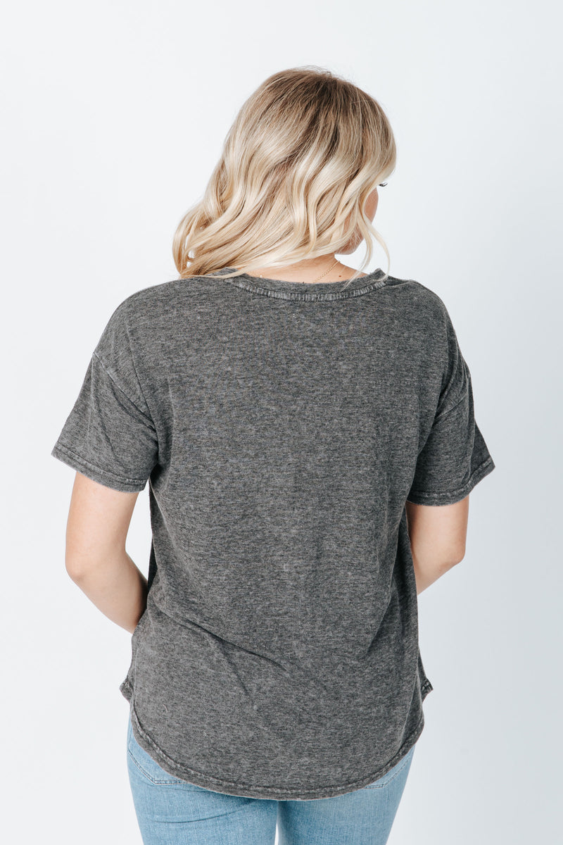 The Distancer Tee in Charcoal, studio shoot; back view