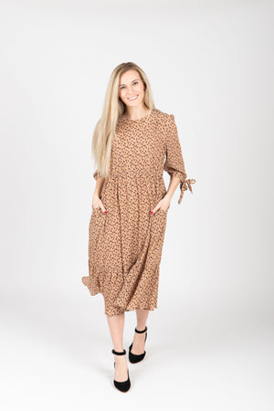 The Elena Patterned Tiered Dress in Nude, studio shoot; front view