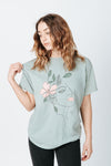 The Flower Lady Graphic Tee in Sage, studio shoot; front view