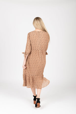 The Elena Patterned Tiered Dress in Nude, studio shoot; back view