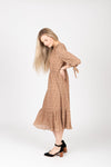 The Elena Patterned Tiered Dress in Nude, studio shoot; side view