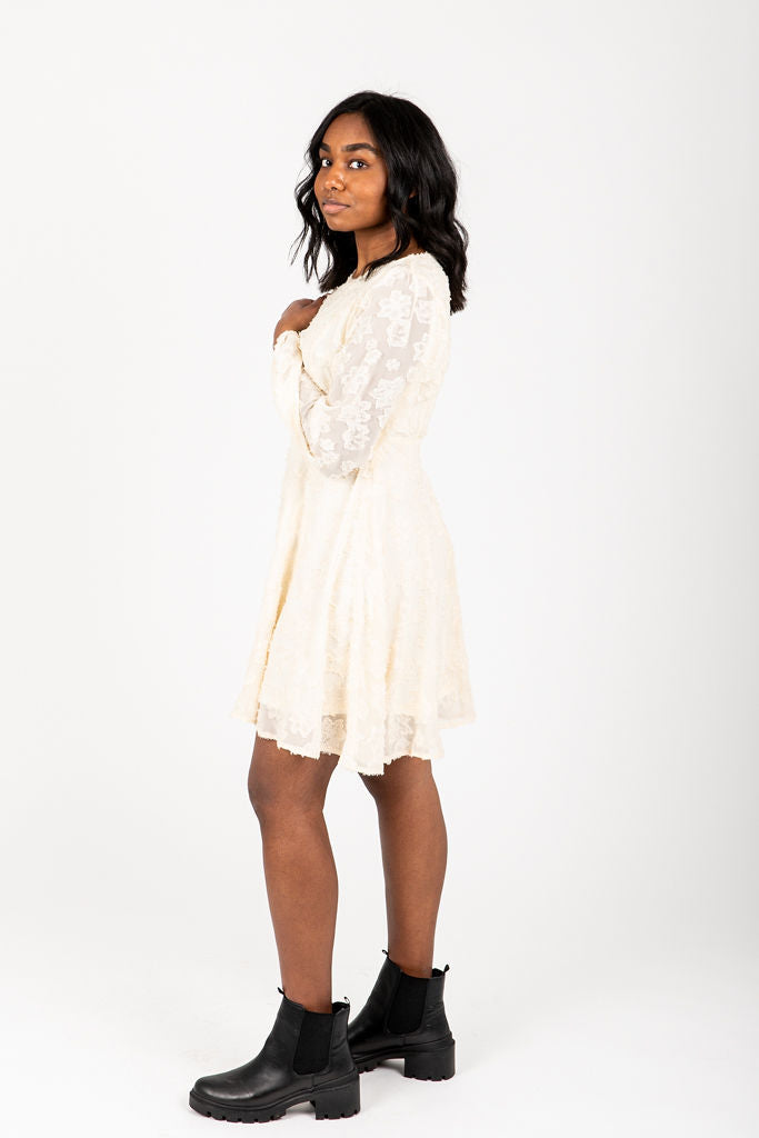 The Kallie Floral Detail Dress in Cream, studio shoot; side view