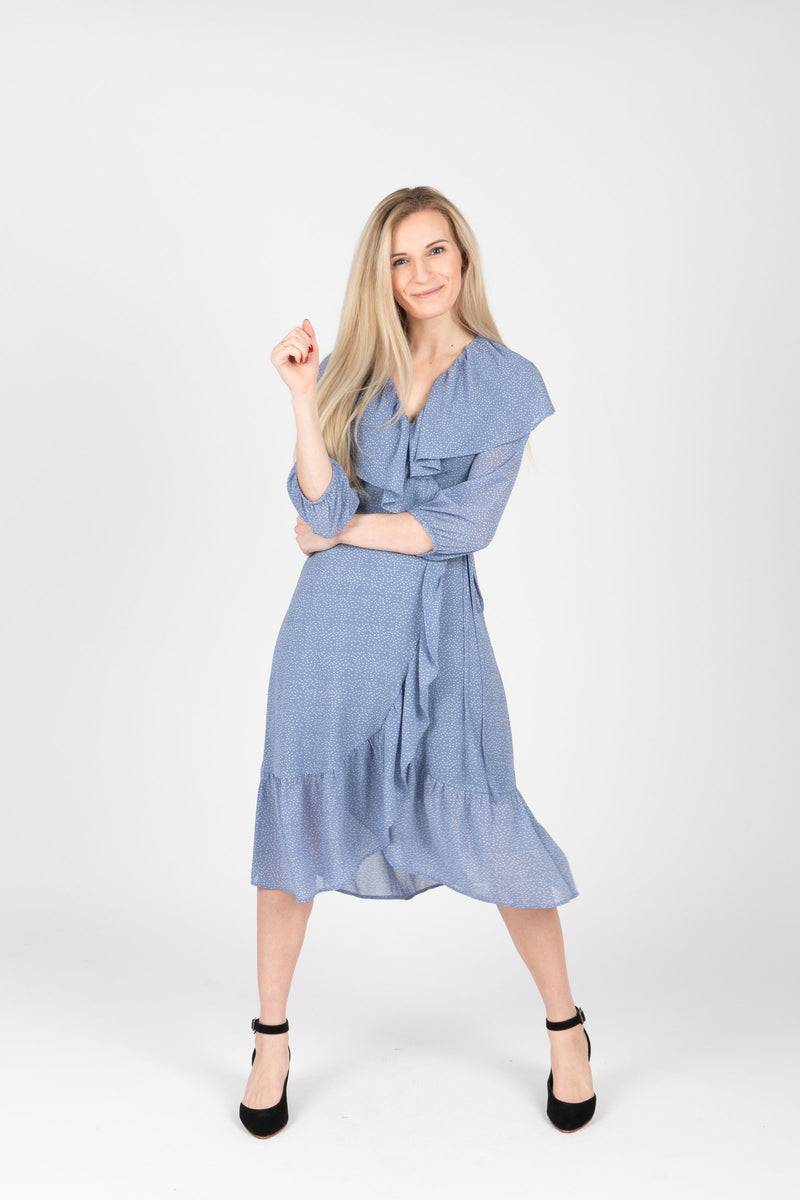 The Vinnie Ruffle Wrap Dress in Powder Blue, studio shoot; front view