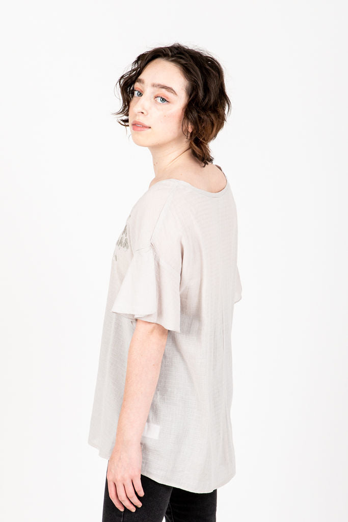The Nicola V-Neck Blouse in Grey, studio shoot; side view