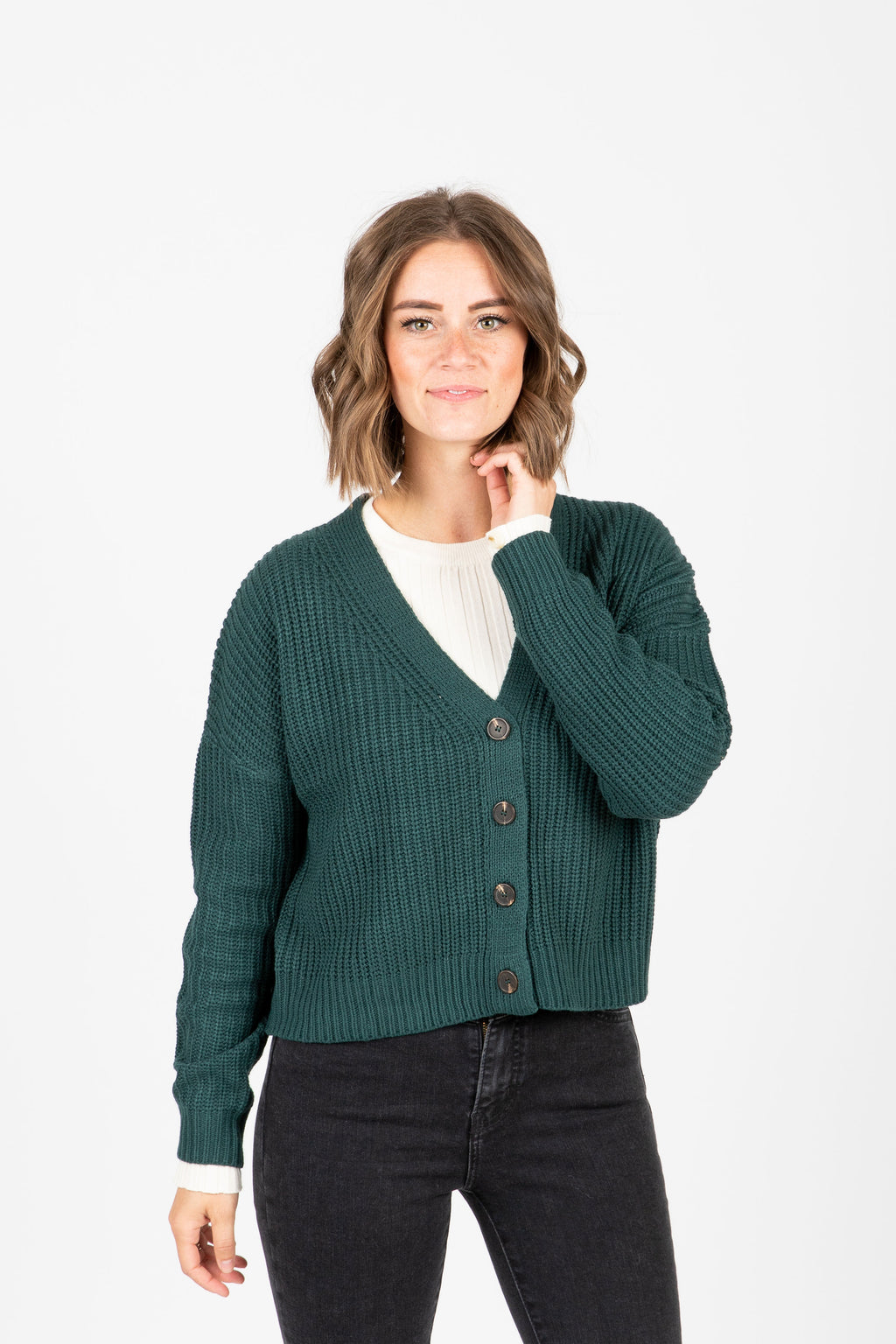 The Dorian Button Cardigan in Hunter Green, studio shoot; front view