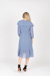 The Vinnie Ruffle Wrap Dress in Powder Blue, studio shoot; back view