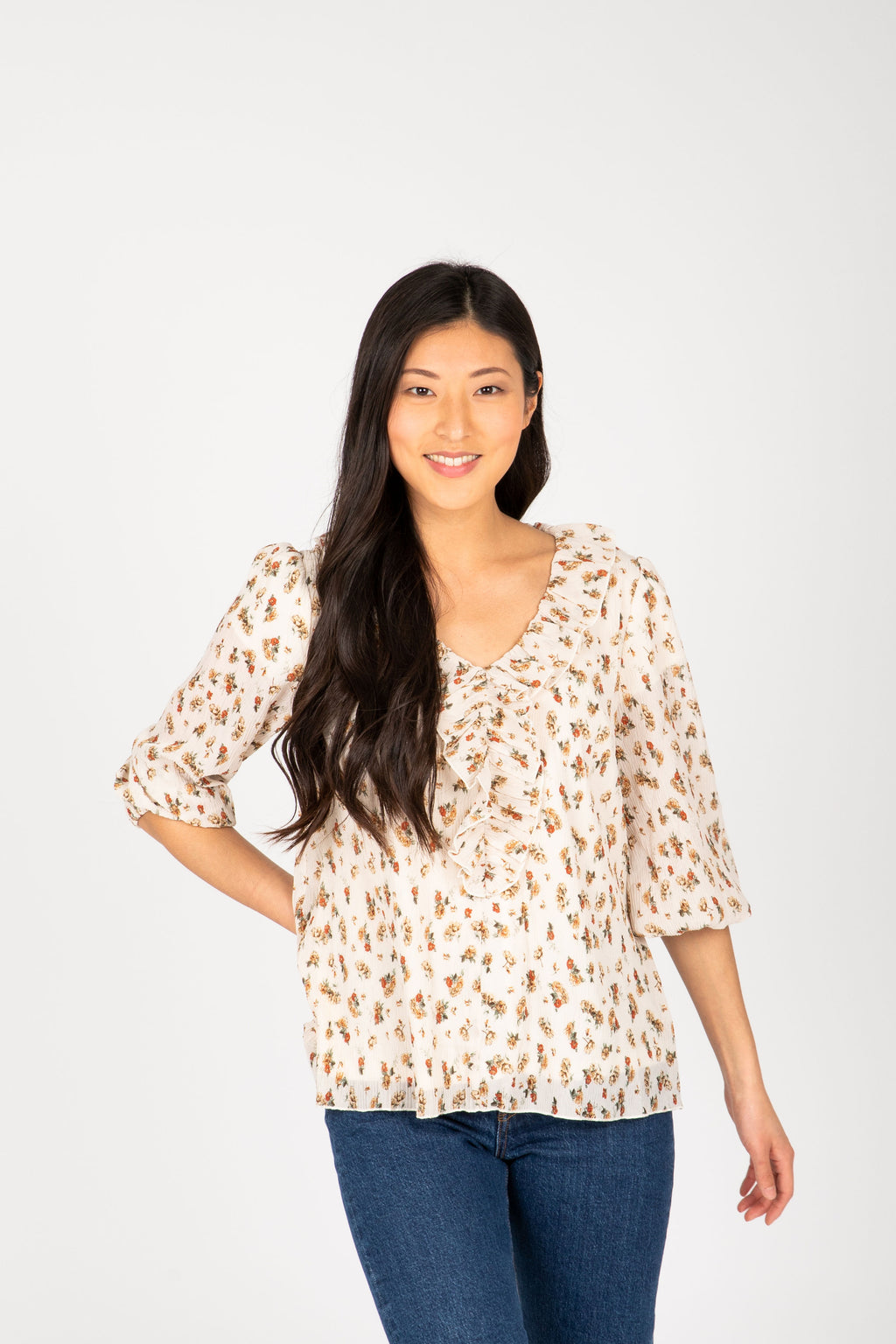 The Etta Floral Ruffle Blouse in Natural, studio shoot; front view