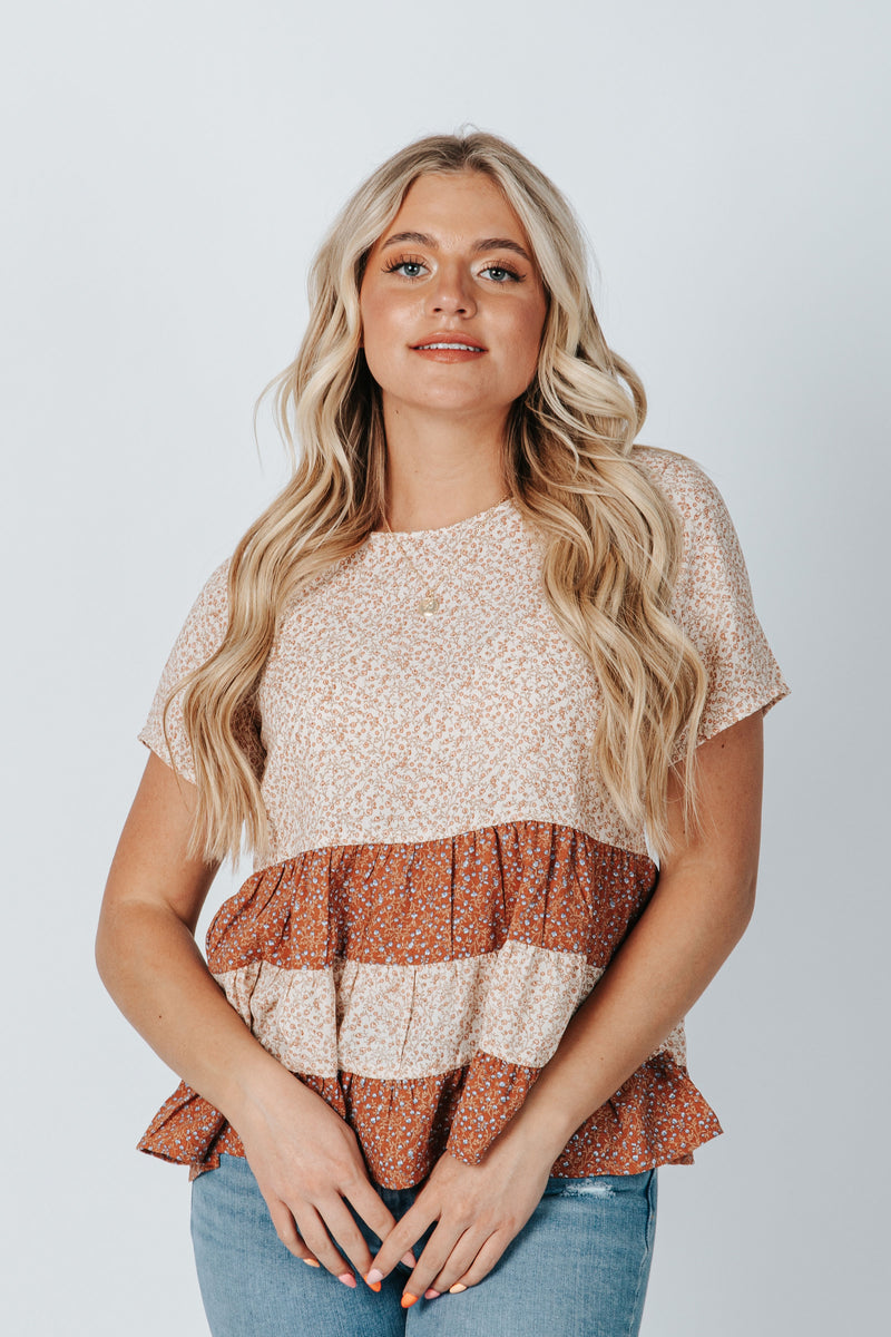 The Newton Floral Peplum Blouse in Dusty Pink, studio shoot; front view