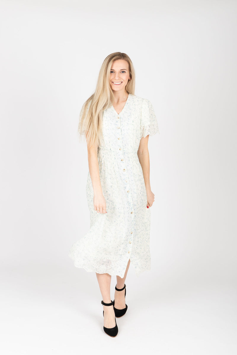 The Givell Floral Detail Dress in Ivory, studio shoot; front view