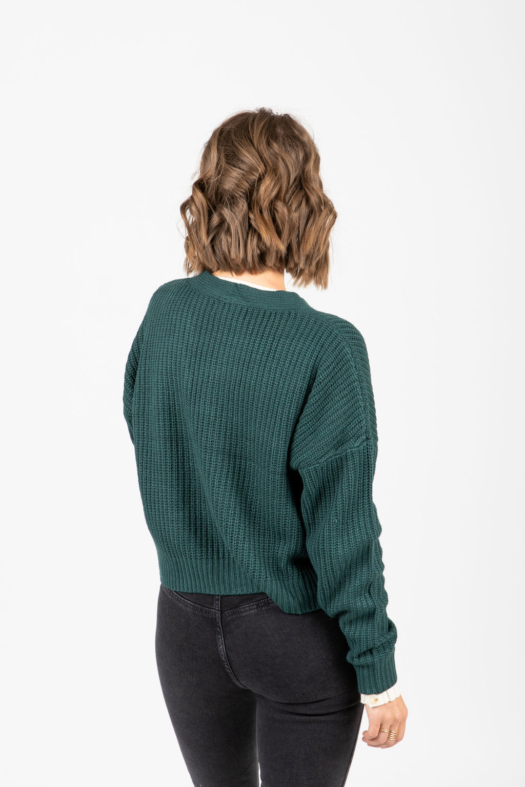 The Dorian Button Cardigan in Hunter Green, studio shoot; back view