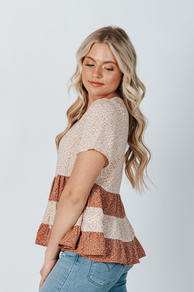 The Newton Floral Peplum Blouse in Dusty Pink, studio shoot; side view