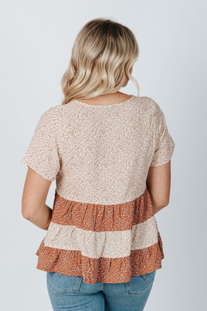 The Newton Floral Peplum Blouse in Dusty Pink, studio shoot; back view