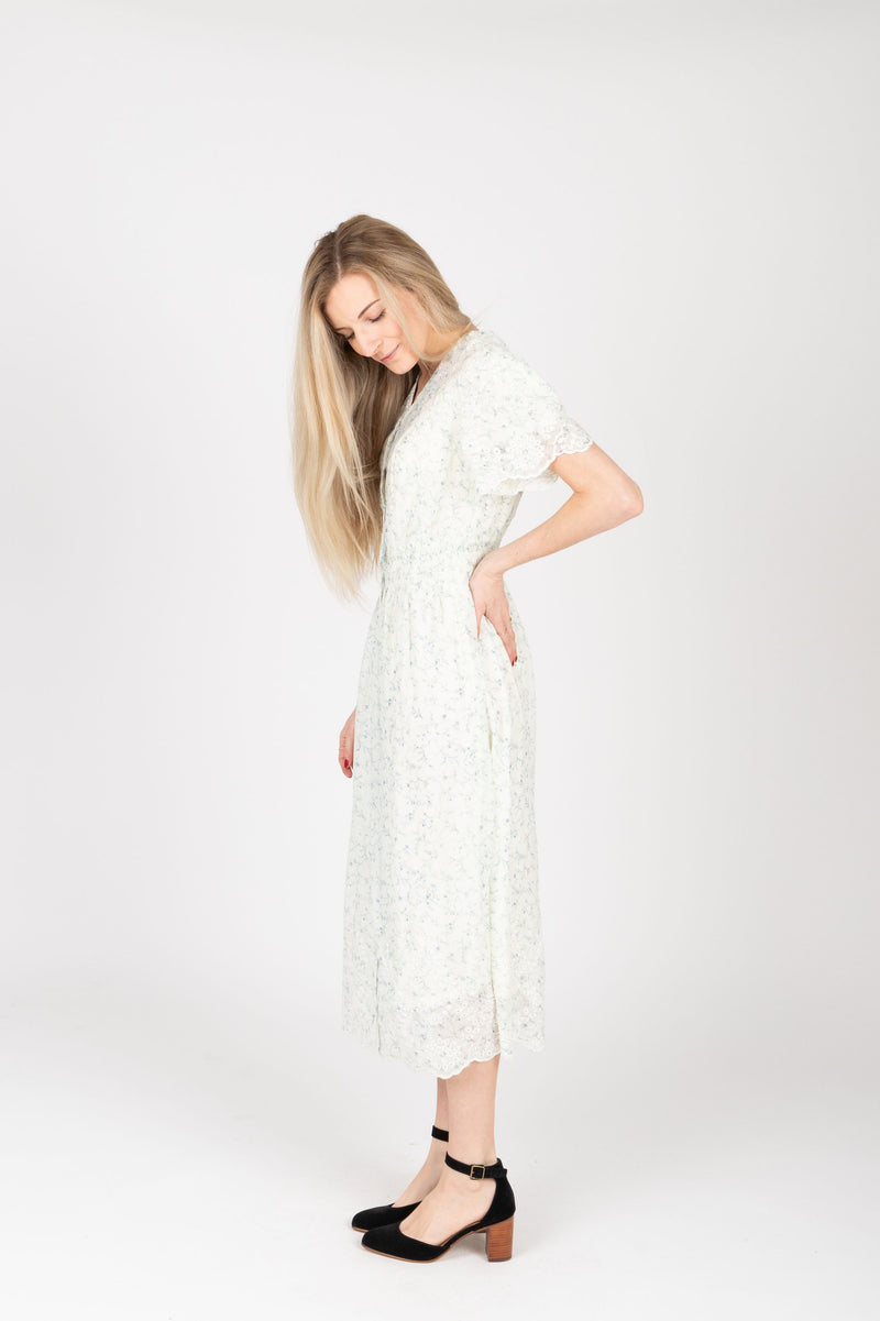 The Givell Floral Detail Dress in Ivory, studio shoot; side view