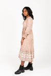 The Sintay Patterned Dress in Dusty Pink, studio shoot; side view