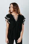 The Tara Ruffle Detail Blouse in Black, studio shoot; front view