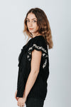 The Tara Ruffle Detail Blouse in Black, studio shoot; side view