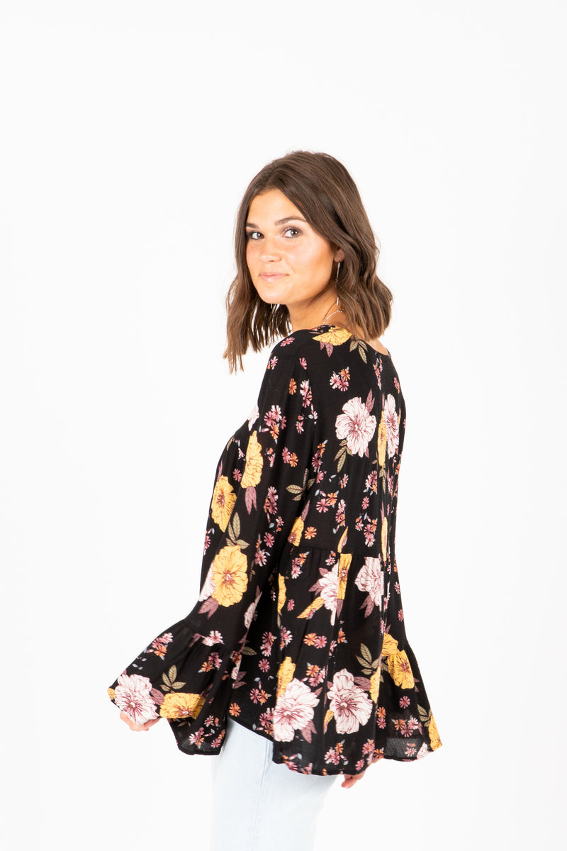 The Natasha Empire Blouse in Pale Yellow Floral, studio shoot; side view