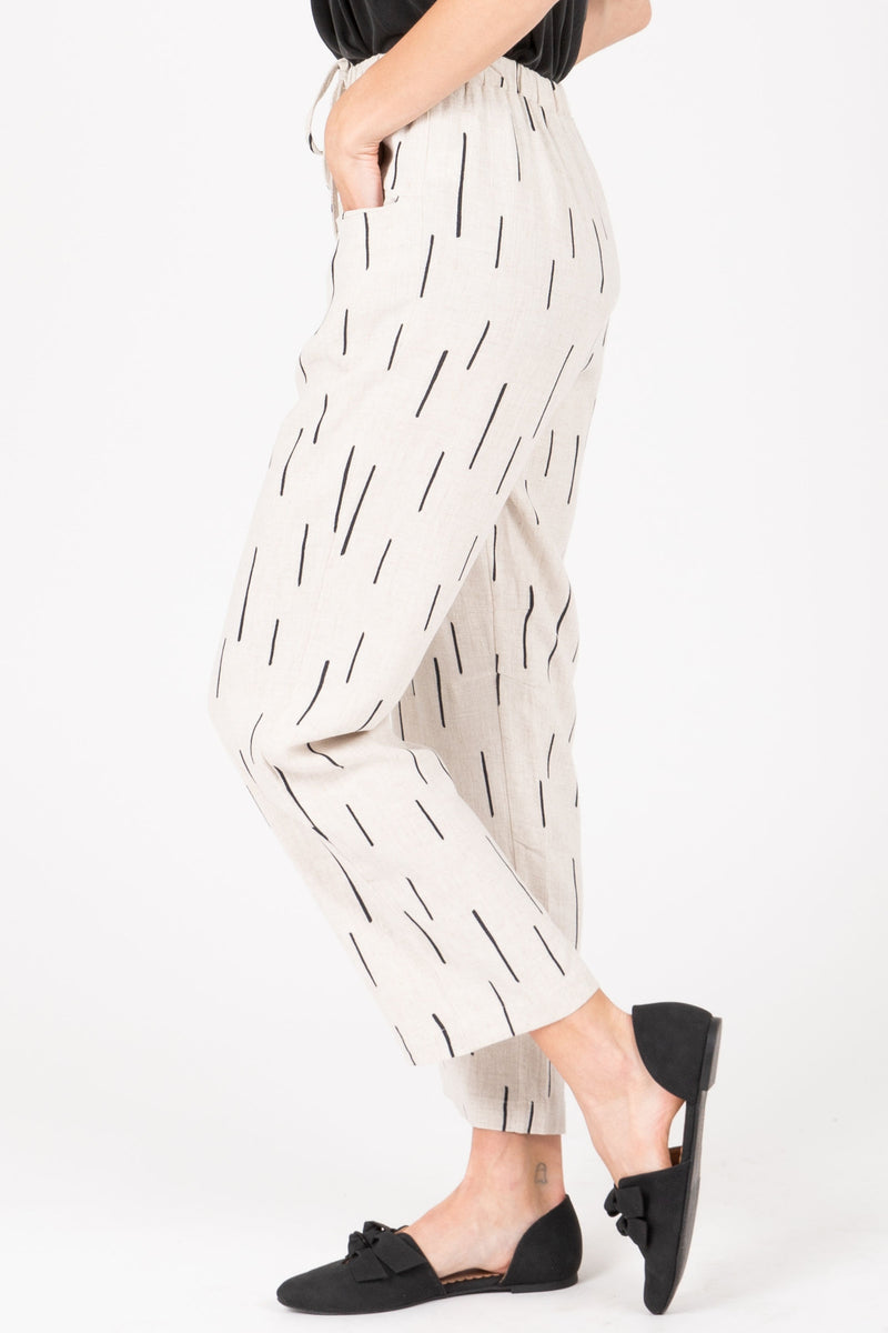 The Gwyneth Dash Trouser in Natural, studio shoot; side view