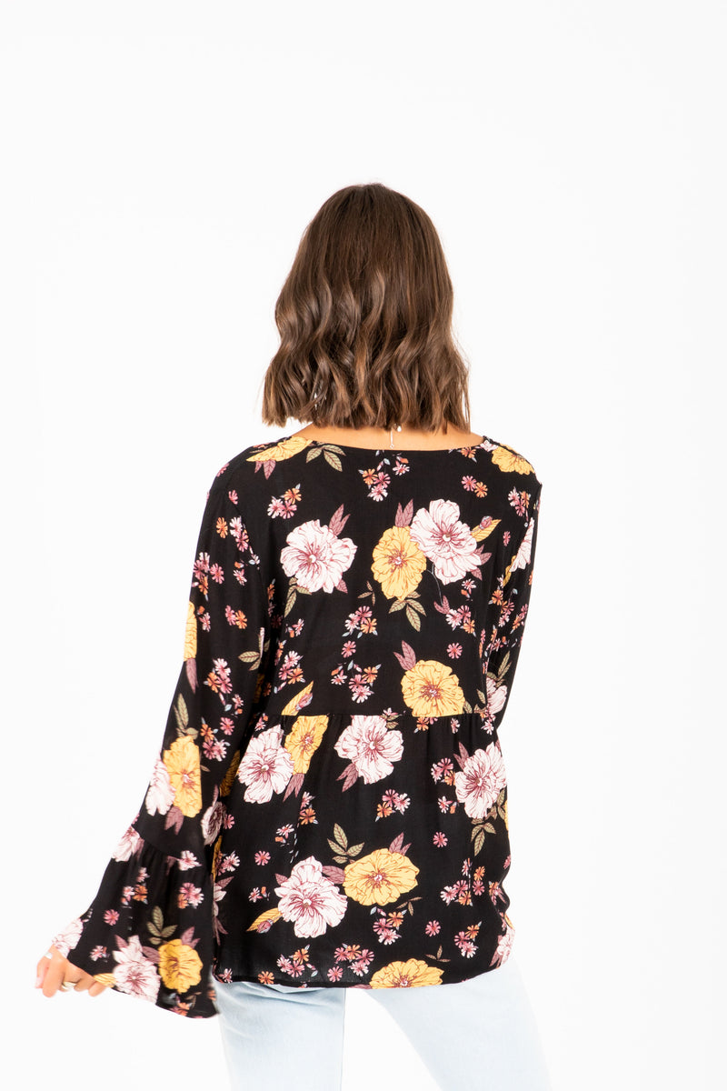 The Natasha Empire Blouse in Pale Yellow Floral, studio shoot; back view