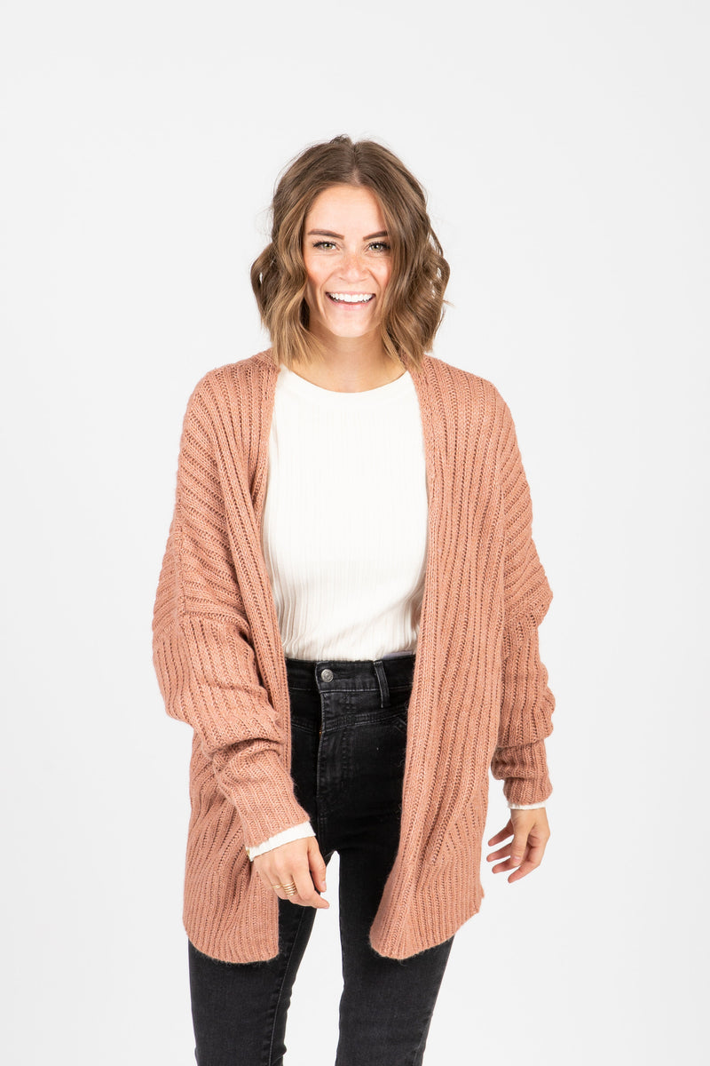 The Ames Ribbed Cardigan in Rose, studio shoot; front view