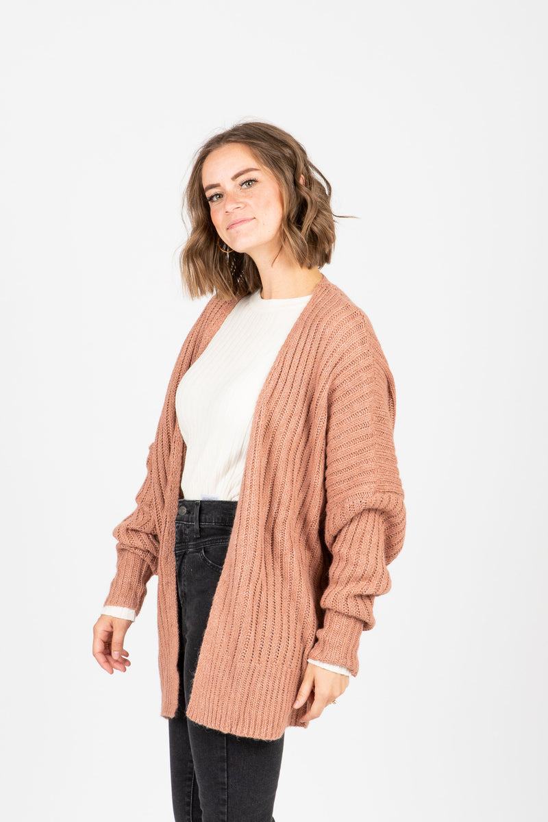 The Ames Ribbed Cardigan in Rose, studio shoot; side view