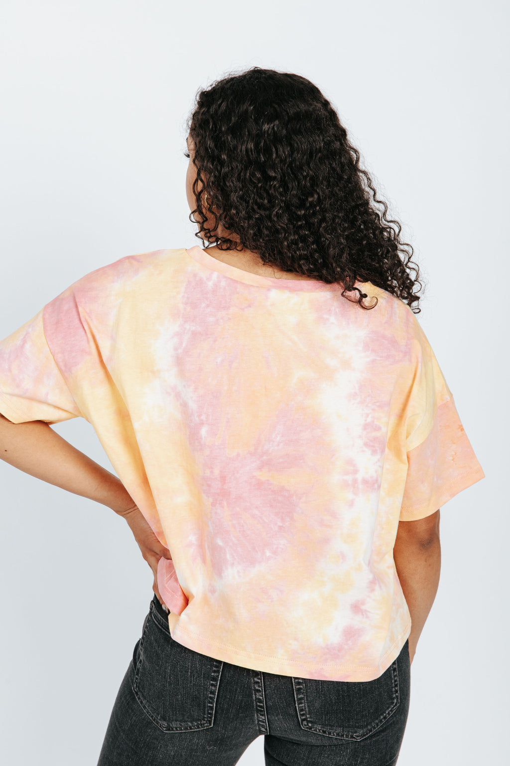 The Harbor Tie Dye Tee in Sunkist, studio shoot; back view