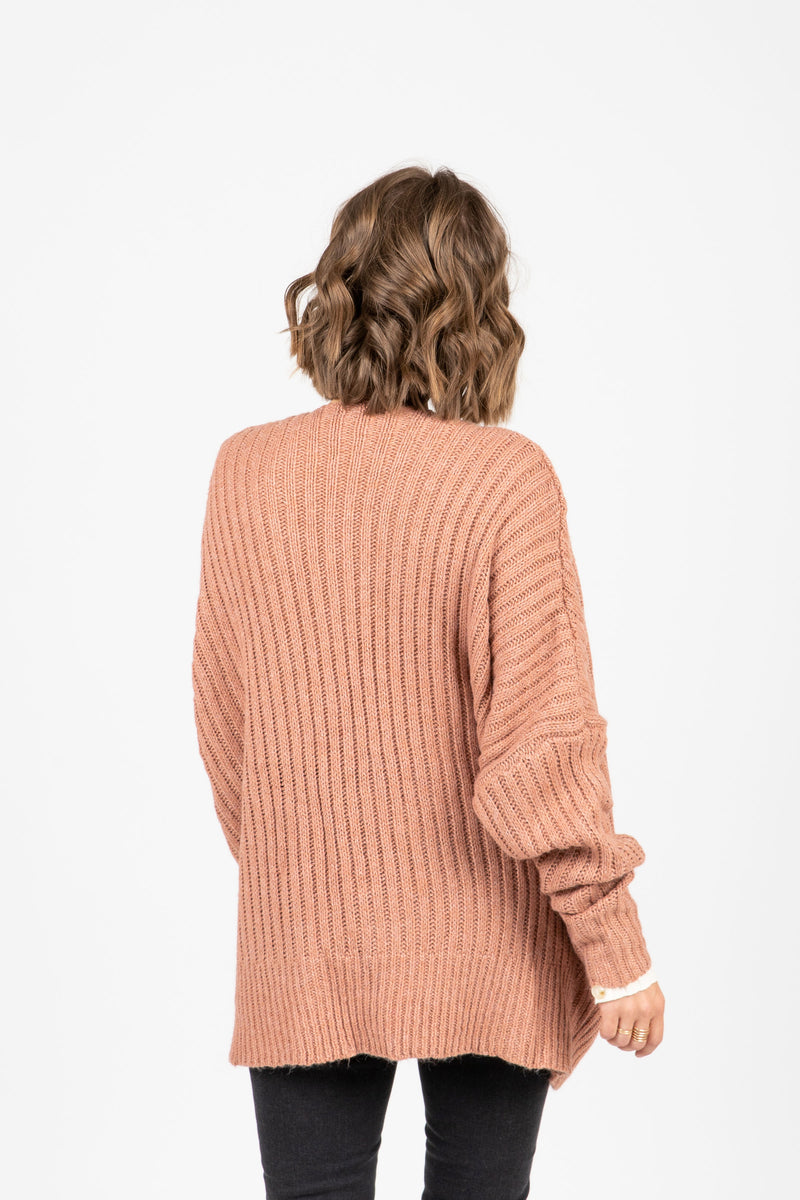 The Ames Ribbed Cardigan in Rose, studio shoot; back view