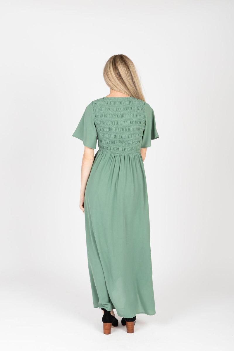 The Fancy Flutter Sleeve Dress in Sage, studio shoot; back view