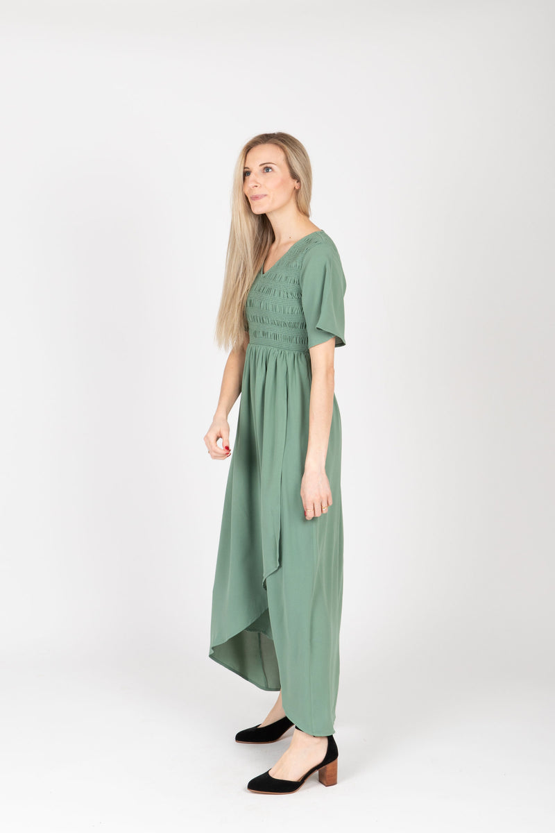The Fancy Flutter Sleeve Dress in Sage, studio shoot; side view