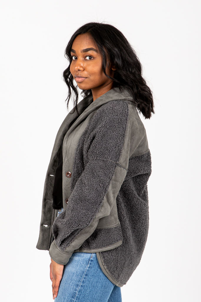 The Rence Sherpa Jacket in Charcoal, studio shoot; side view