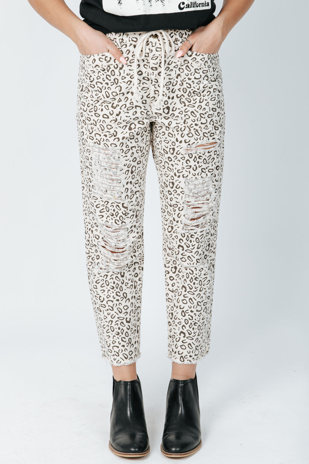 The Finlay Ripped Trouser in Leopard Print, studio shoot; front view