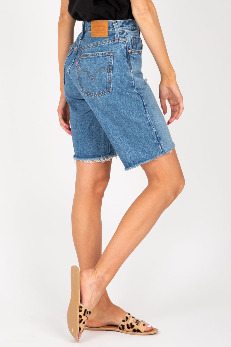 Levi's: 501 Long Short in Athens Sights Medium Wash, studio shoot; side  view
