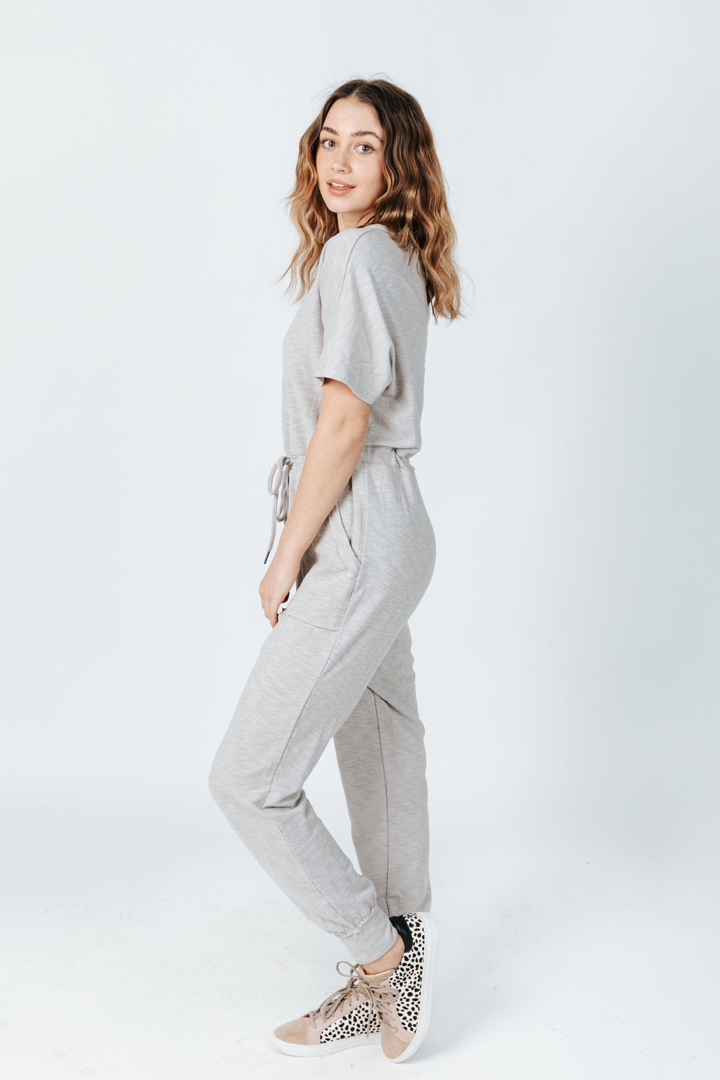 The Hugh Casual Jumpsuit in Heather Grey, studio shoot; side view