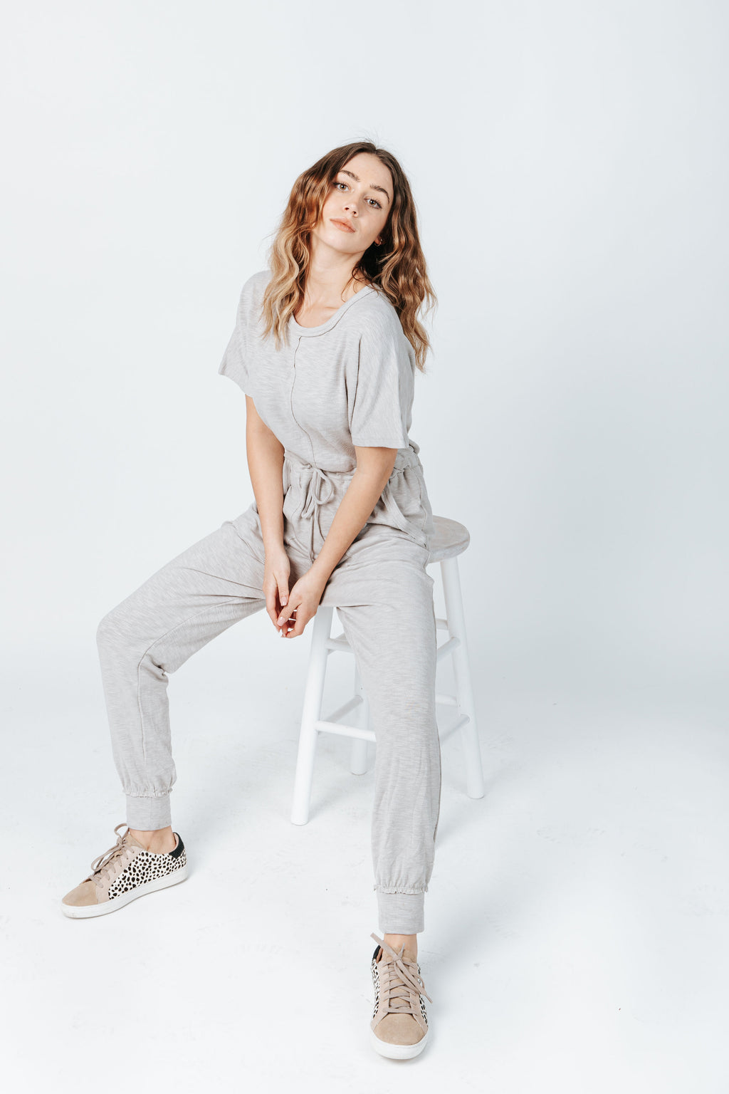 The Hugh Casual Jumpsuit in Heather Grey, studio shoot; front view